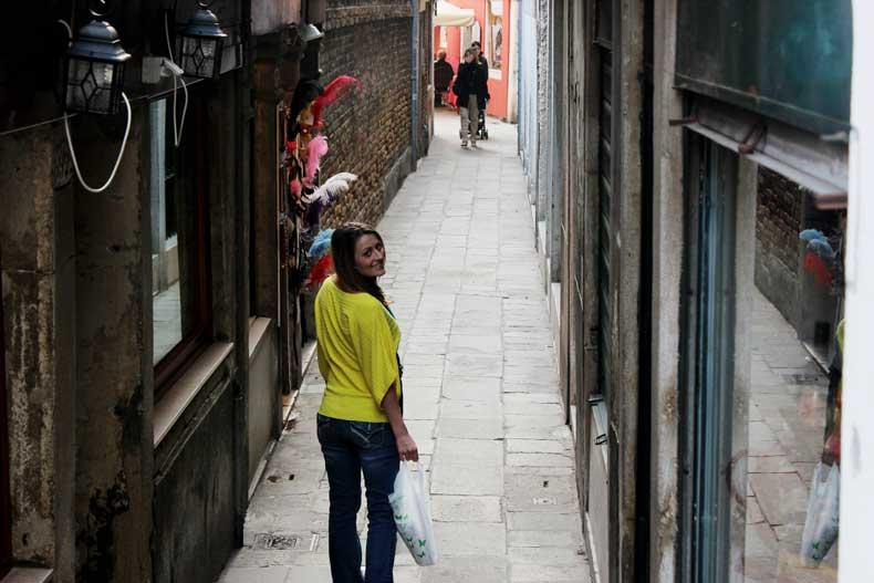 Walking down a small street in Venice