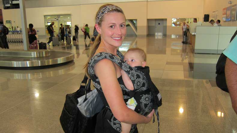 Baby in a baby carrier - a travel baby essential