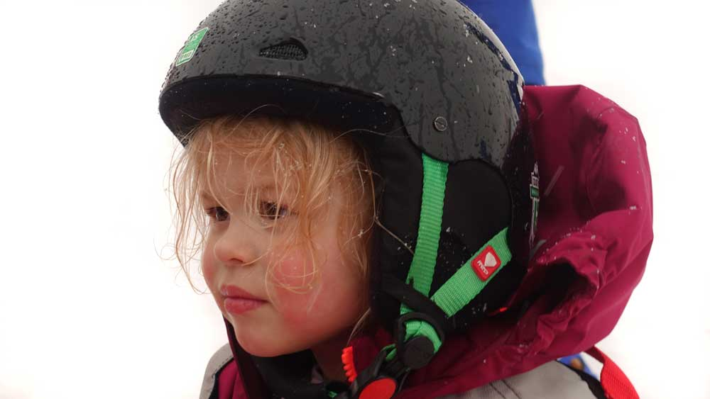 How to teach a toddler to ski - toddler in ski helmet and ski gear