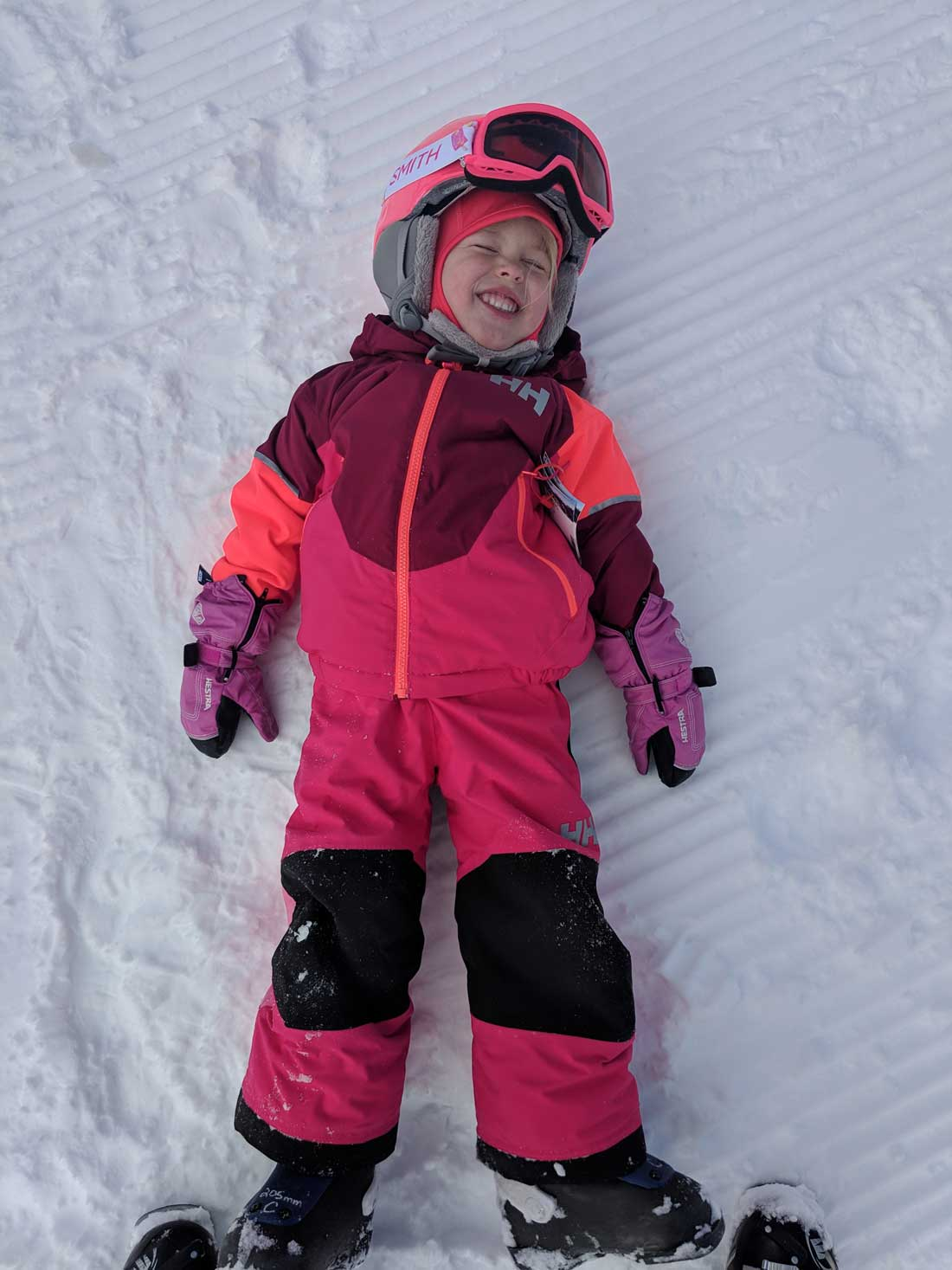 toddler skiing tips - child playing in snow