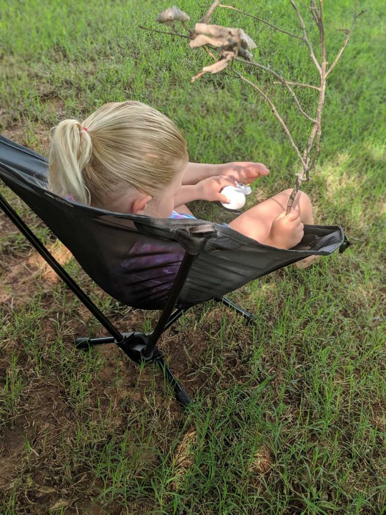 camping kids gear - child sitting in portable chair