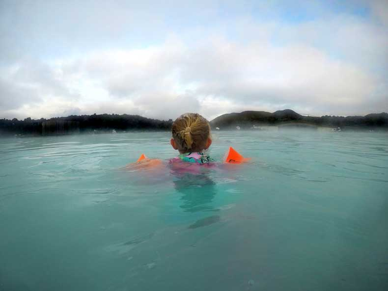 Blue Lagoon with kids - child swimming in Lagoon with floaties