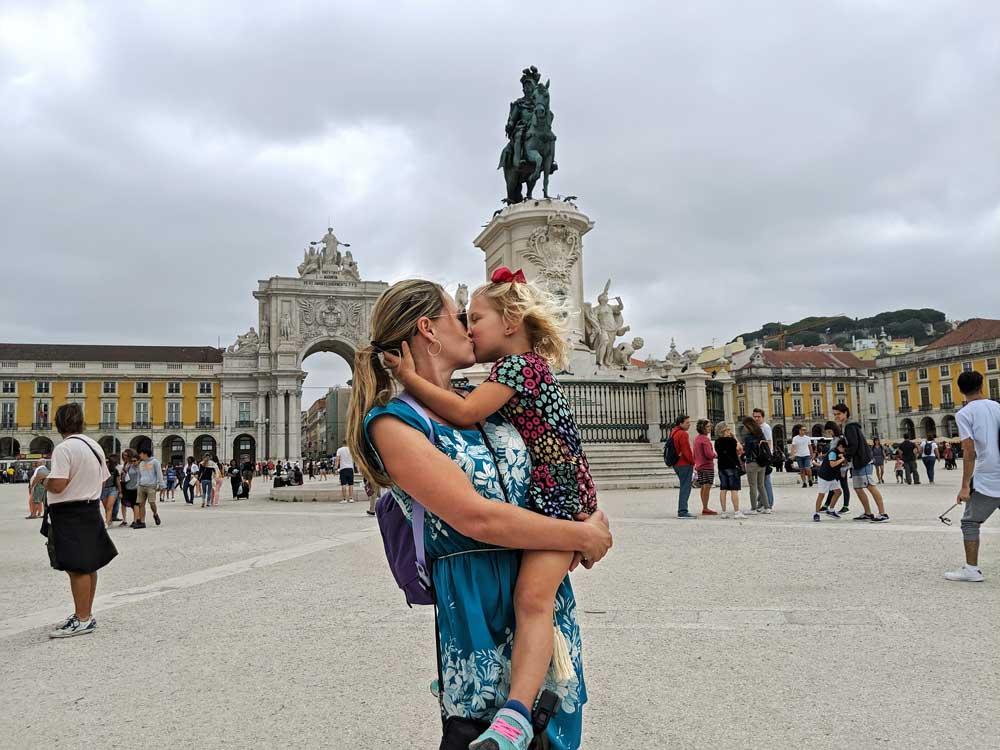 family at Praca do Comercio in Lisbon with a child