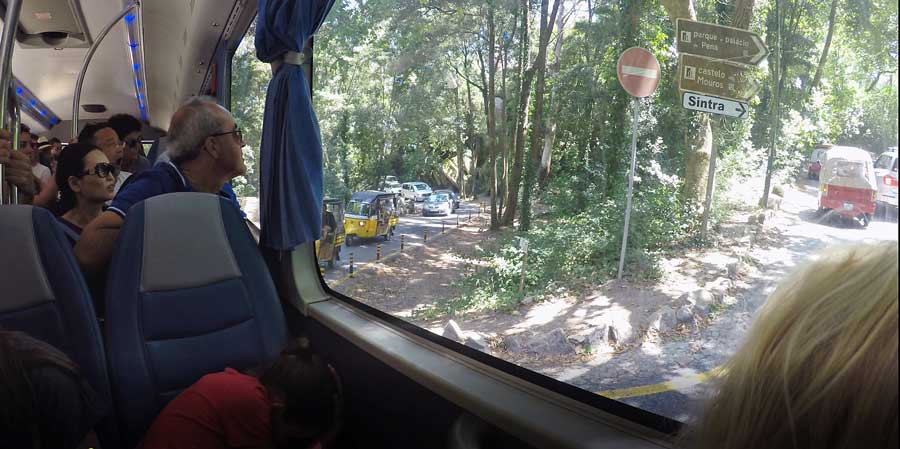A packed bus full of tourists on a Lisbon to Sintra day trip