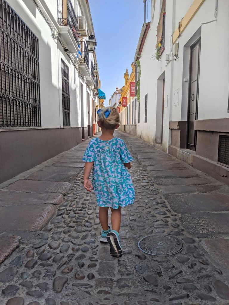 child walking down an empty street in Cordoba