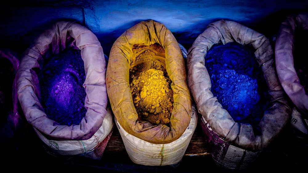 Bags of colorful dye that line the streets in Morocco