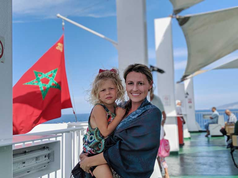 Woman and child in front of the Morocco flag