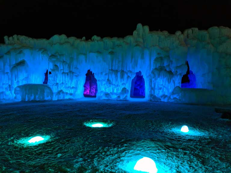 Glowing lights and archways at Ice Castles in New Hampshire