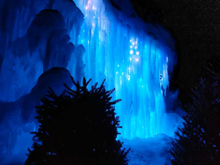Glowing blue ice at one of the Ice Castles in the USA located in New Hampshire
