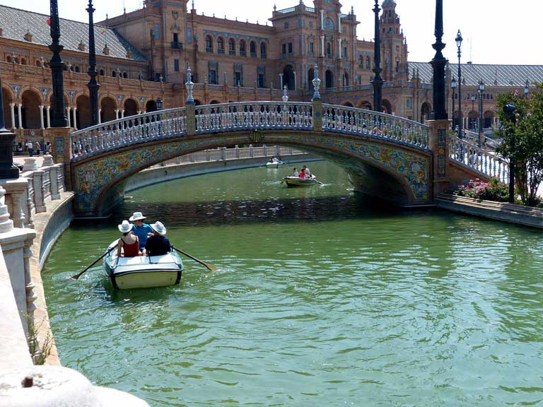 Paddle boats on the canal at Plaza de Espana in Seville