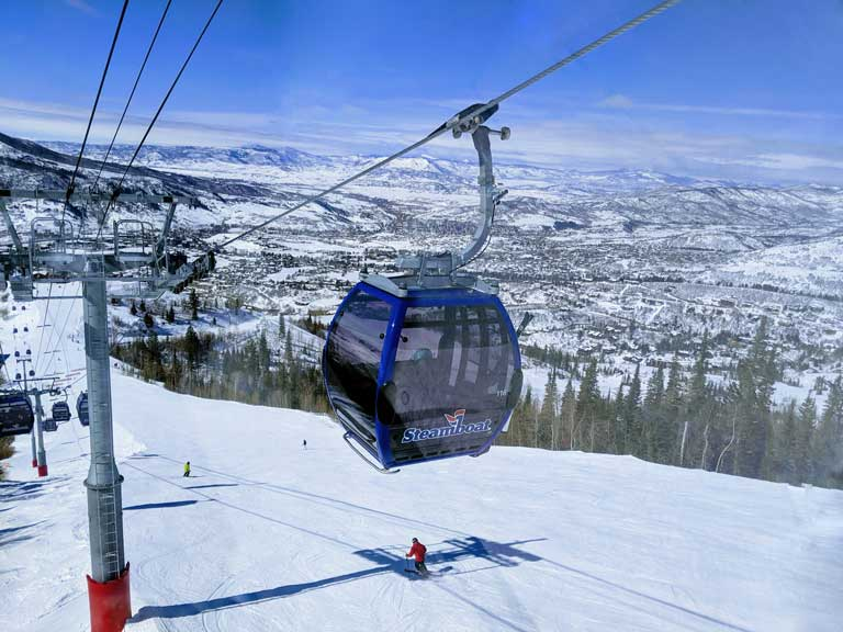 skiers underneath the gondola at Steamboat Mountain Resort