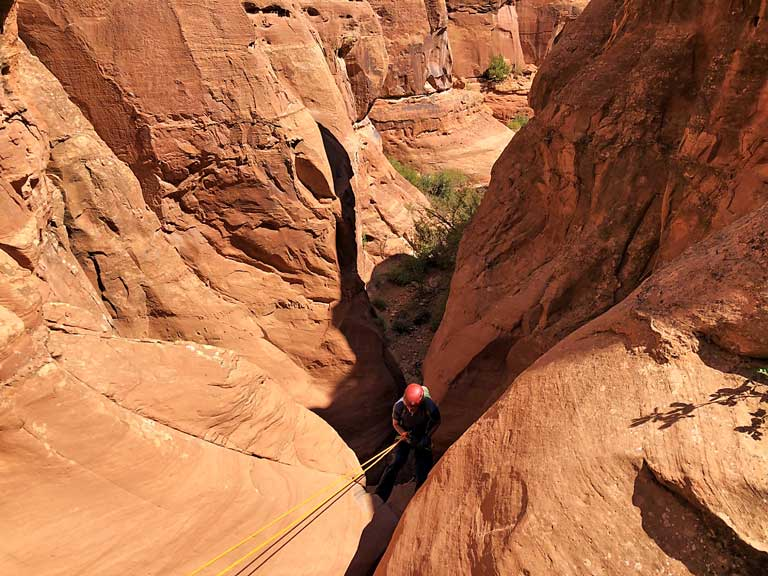 Rappelling into Granary Canyon near Moab