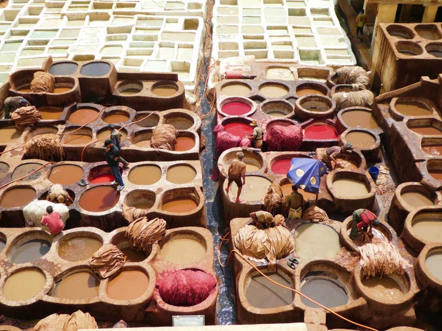 Watching men working in the tanneries in Fes is one of the best things to do in Morocco