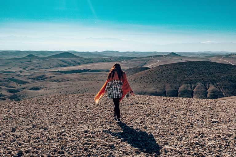 Woman walking in Agafay Desert in Morocco