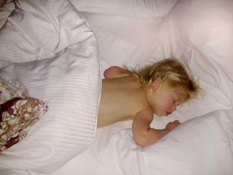 baby sleeping in a hotel room