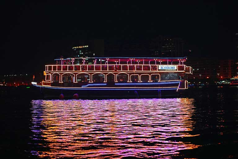 A dhow cruise ship in Dubai at night