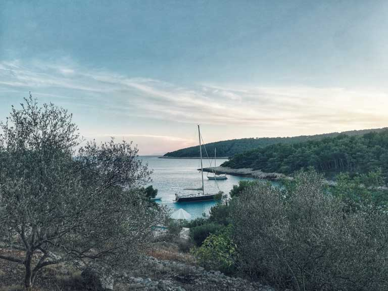a harbor and beach in Korcula Croatia, beach hopping is one of the most popular activities in Korcula