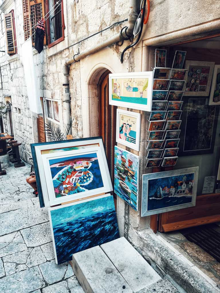 A shop in Old Town Korcula selling local paintings.