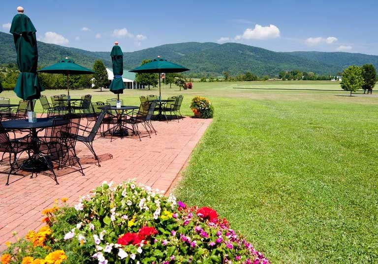 outdoor seating area near the lawn at Kings Family Vineyards
