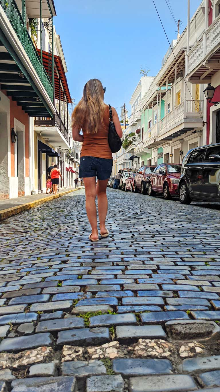 walking down blue stone streets surrounded by colorful buildings in Old San Juan Puerto Rico