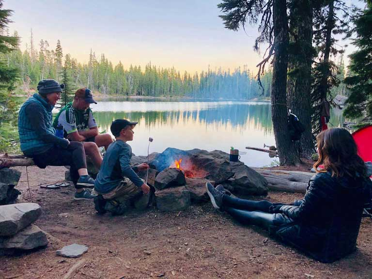 family camping and making roasted marshmallows