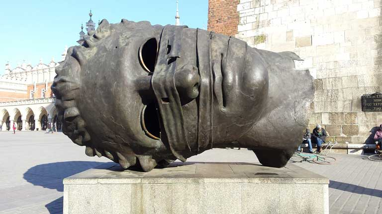 Eros Bendato, commonly referred to as The Head - one of the most famous statues in Europe - in Krakow Poland