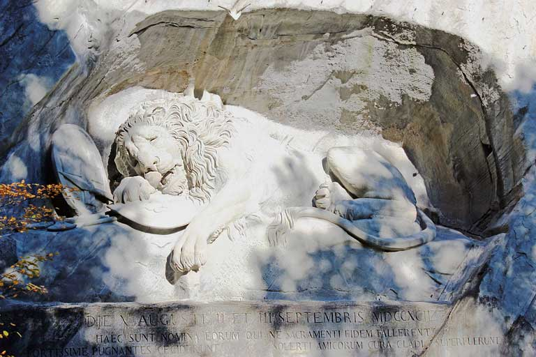 Lion of Lucerne, one of the most moving statues in Europe, carved in a rock facade in Lucerne, Switzerland.
