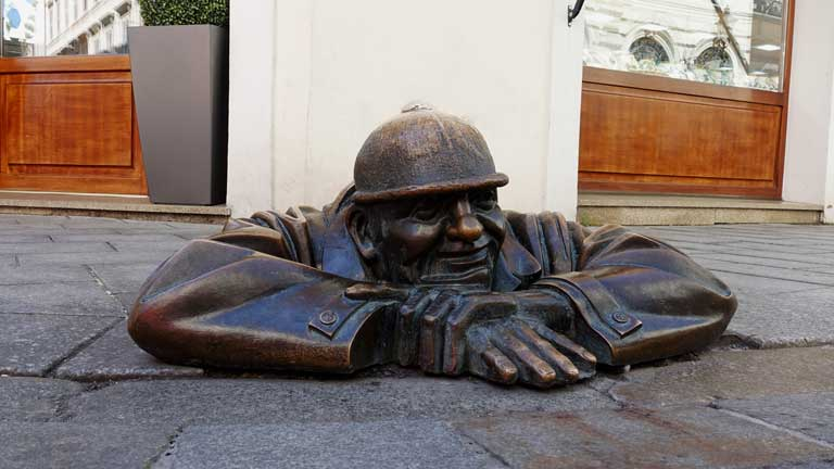 Cumil, one of the most popular statues in Old Town Bratislava, Slovakia.